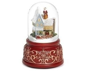 Père Noël sur le Toît de la Maison Boule à Neige Musicale