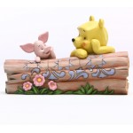 Winnie and Piglet on a Log Disney Tradition
